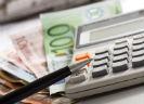 Rekenmachine met geld en pen